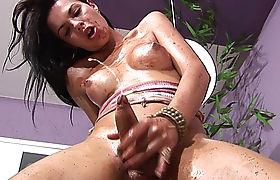 Teen shegirl shows off pretty face and big ass in panties